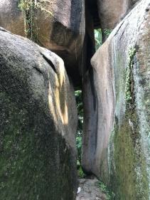 A delightfully narrow crack to walk through in the Camoes Garden